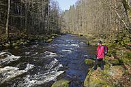 Germany, Lower Bavaria, Bavarian Forest, hiker at the Ilz near Diessenstein - LBF000865