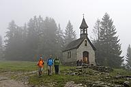 Germany, Bavaria, hikers at St Anne's Chapel near Reit im Winkl - LB000887