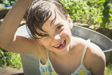 Portrait of laughing little girl with wet hair in the garden - LVF001584