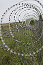Germany, Bavaria, Oberpfaffenhofen, Barbed wire fence at airport - CRF002597