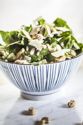 Caesar Salad with roasted cashews in a bowl - SBDF001017