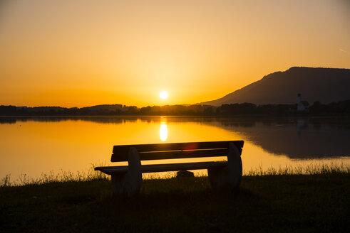 Germany, Bavaria, Allgaeu, East Allgaeu, Lake Forggensee, Bench at sunrise - WGF000337