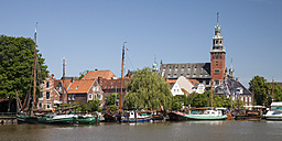 Germany, Lower Saxony, Leer, view to the city with museum harbour in front - WIF000892