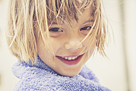 Portrait of smiling ittle girl with towel - LVF001636