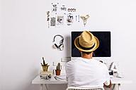Man at desk in white workroom - EBSF000257