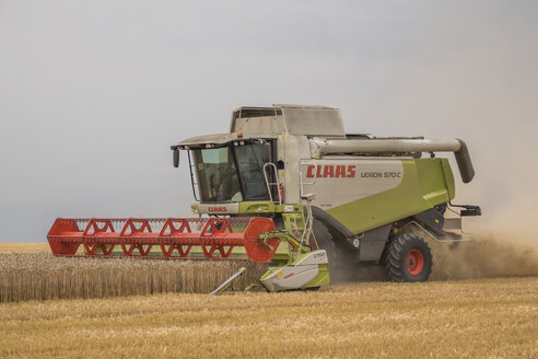Germany, Lower saxony, combine harvester at work - PVC000203