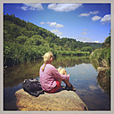 Belgium, Province Luxembourg, The Ardennes, woman/ hiker resting at Semois River, region Vresse-sur-Semois - GWF003032