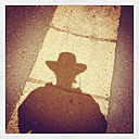 Belgium, Province Luxembourg, The Ardennes, shadow of woman with western style hat - GWF002942