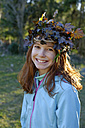 Portrait of happy girl with crown of autumn foliage on her head - LBF000864