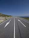 Spain, empty mountain road with directional arrows - LAF000900