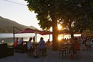Austria, Salzburg State, Fuschlsee Lake, Fuschl am See, Restaurant in the evening - SIE005684