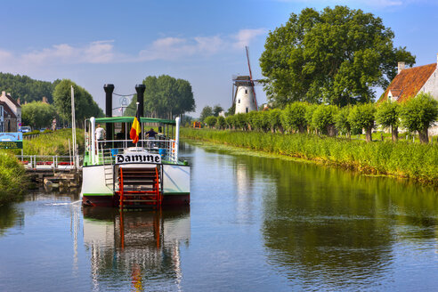 Belgium, Flanders, West Flanders, Bruges, canal at Damme with old boat - AM002594