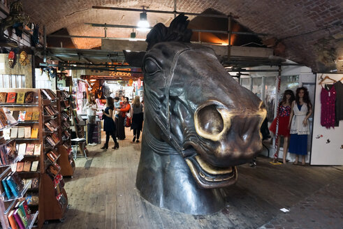 UK, London, Camden, oversized sculpture of horse's head at Stables Market - WE000184