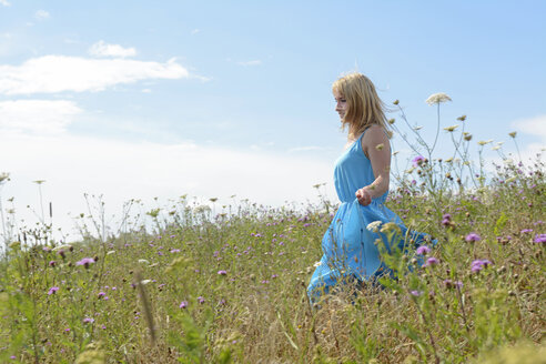 Young woman on wildflower meadow - BFRF000474
