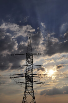 Germany, Saxony, Power pole in the evening against the sun - LYF000224