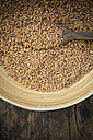 Emmer wheat , Triticum dicoccum, in a bowl, wooden spoon - LVF001693