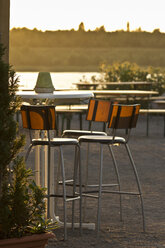 Saxony, empty chairs in a beer garden at evening twilight - MELF000011