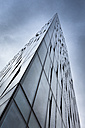 Island, Reykjavik, glass facade of office building, view from below - FCF000344