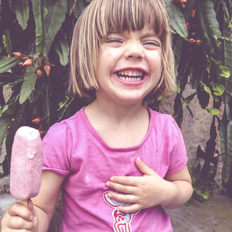 Laughing girl eating popsicle - LVF001709