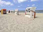 Germany, Lower Saxony, Hooksiel,  Beach chairs at North Sea - OD000787