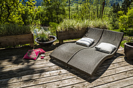 Two sun loungers on wooden terrace - TCF004148