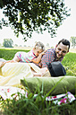 Young couple and little daughter relaxing in nature - UUF001543