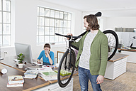 Man leaving the office with bicycle on his shoulder - RBF001772
