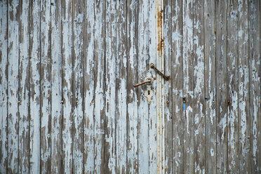 Weathered old wooden door with rusty chain and door handle - BSC000439