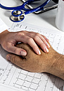 Doctor holding patient's hand - EJWF000455