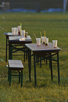 Outdoor beer tables and benches with leftovers of a party - MELF000015