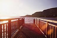 Italy, Lake Garda, Jetty at sunset - ZMF000333