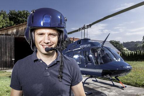 Germany, Bavaria, Landshut, Helicopter pilot wearing helmet - KDF000063