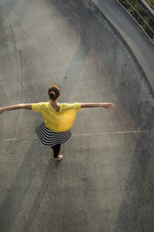 Young ballet dancer exercising on a parking level - UUF001622