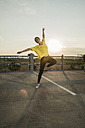 Young ballet dancer exercising on a parking level - UUF001624