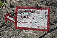Montenegro, Crna Gora, Lovcen National Park, Painted waymarker at Krstac - ES001320