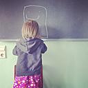 Germany, Baden-Wurttemberg, Tubingen, Little girl drawing with chalk - LVF001771