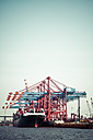 Germany, Hamburg, Port of Hamburg, Container ship and container cranes - KRP000951