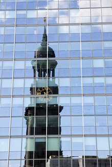 Germany, Hamburg, reflection of St. Michaelis Church in glass front - KRPF000958