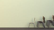 Three stacks of chairs on oak wooden floor in front of a wall, 3D Rendering - UWF000150