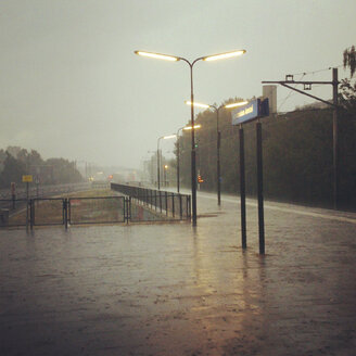 The Netherlands, North-Holland, Amsterdam, Strong rain in the morning on Amsterdam Amstel train station - HAWF000434