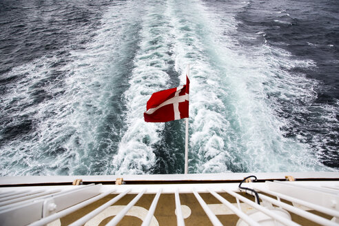 Denmark, Danish flag on ferry on the sea - NG000129