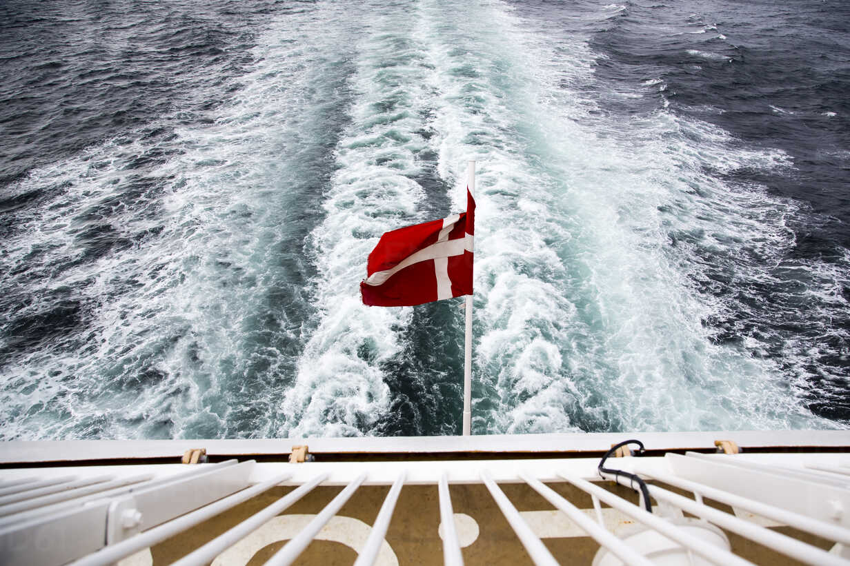 Denmark, Danish flag on ferry on the sea - NG000129 - Nadine Ginzel/Westend61