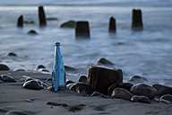 Germany, Mecklenburg-Western Pomerania, Ruegen, Message in a bottle at beach - PA000735