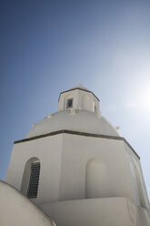 Greece, Cyclades, Santorini, view to part of a white church at back light - KRPF000845