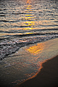 Greece, sunlight reflecting on the water at a beach - KRPF000863