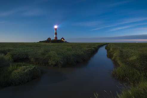 Germany, Schleswig-Holstein, North Sea Coast, View of Westerheversand Lighthouse, Blue hour - RJF000253