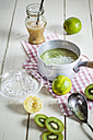 Chilled kiwi soup in pot with limes and honey - SBDF001175