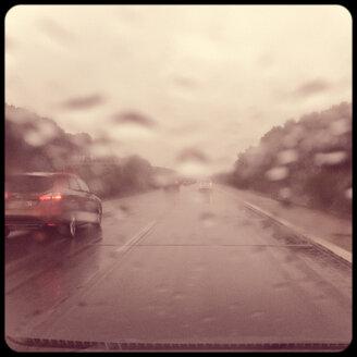 Cars on street in rain - SHIF000050