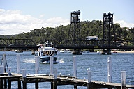 Australia, New South Wales, Eurobodalla, Batemans Bay, bridge across the Clyde River with boat - MIZ000535