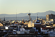 Spain, Madrid, view over the roofs of Malasana towards the Faro de Moncloa - MIZ000611